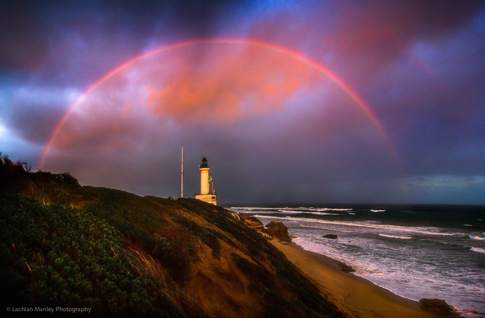 A red rainbow frames the Point Lonsdale Lighthouse, Victoria, at sunset on 12 June 2016. ----
