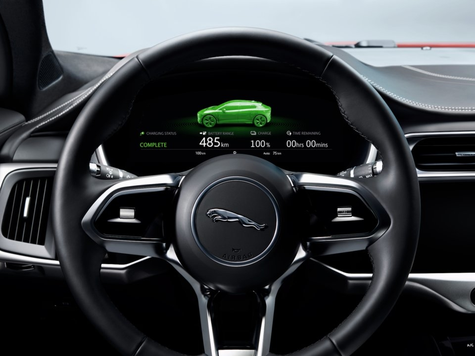 The vehicle has a digital dashboard and a heads-up display.
