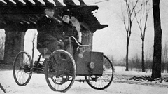 Henry Ford and his wife in his first car, the Ford Quadricycle.