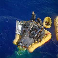 Recovery of Gemini 8 from the western Pacific Ocean; Armstrong sitting to the right.