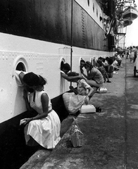 1963- Members of the American Navy say their last goodbyes to their wives before they prepare to depart for duty in Vietnam