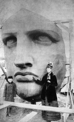 The woman who was the model for the face of the Statue of Liberty standing beside it
