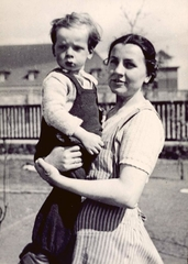Jehova's Witness Gertrud Poetzinger holding a child in the Oranienburg Concentration Camp, Germany.
