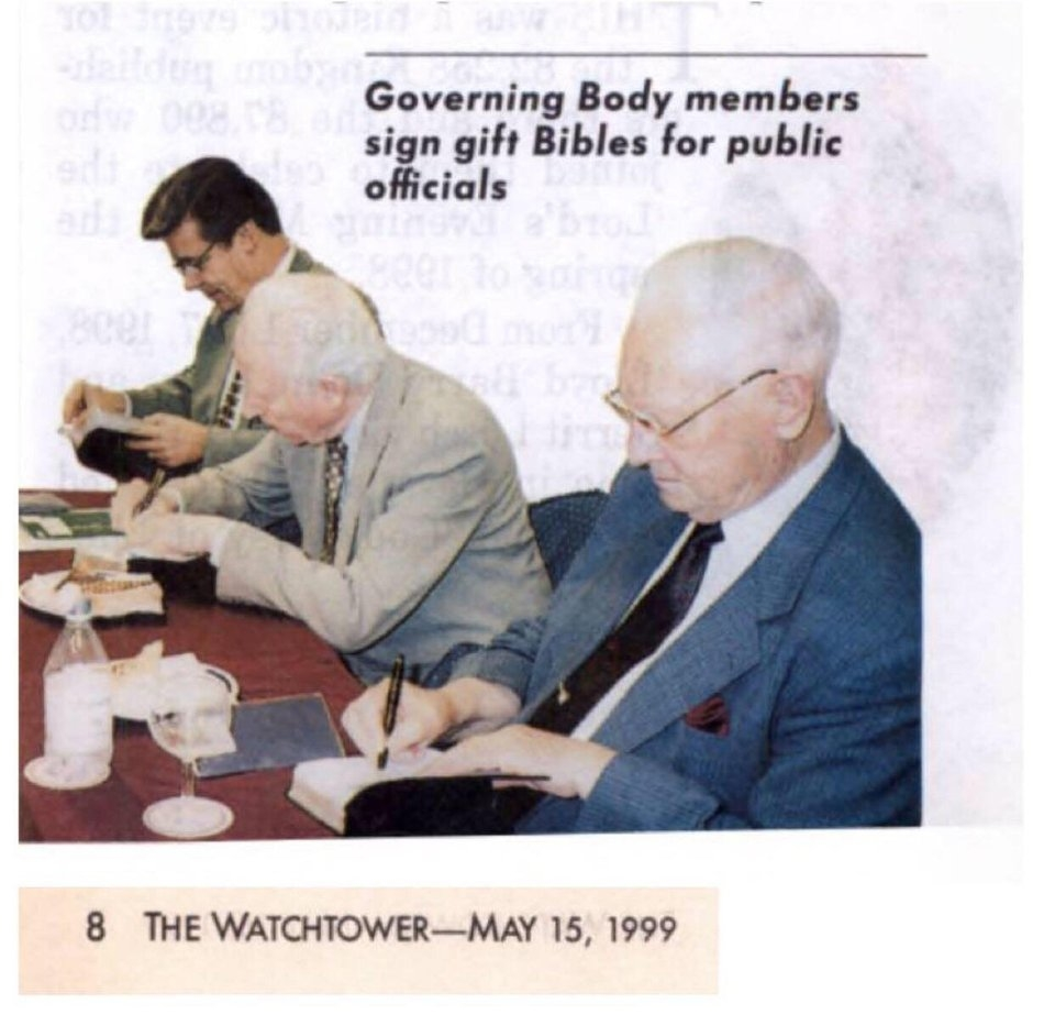 Governing Body members signing bibles.
