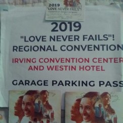 "Here's my two 2019 "" LOVE NEVER FAILS"" Programs , my Parking Garage Pass, and my lapel card!"